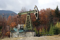 Oil pump in the Carpathian Mountains Royalty Free Stock Photo