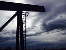 Oil pump, cloudy sky Royalty Free Stock Photography