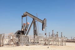 Oil pump in the desert stock photography