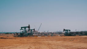 Oil Pump. Extraction of Oil Pumping Station. Oil Pump, Fossil Fuel Energy, Old Pumping Unit. Platform. Extraction of pumping station. Industrial oil pump jack stock footage