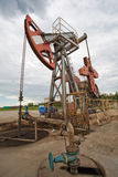 Oil pump in the field Stock Photo
