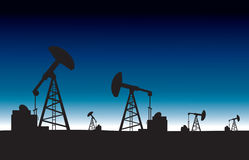 Oil pump field at dawn background Stock Photo