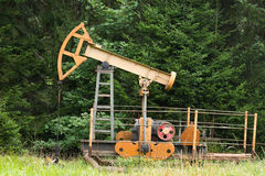 Oil pump in the forest Royalty Free Stock Photography