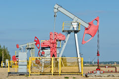 Oil pump. Oil and gas industry. Work of oil pump jack on a oil field Stock Photos