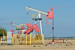 Oil pump. Oil and gas industry. Work of oil pump jack on a oil field Royalty Free Stock Photography