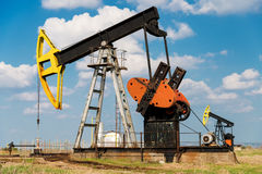 The oil pump, industrial equipment. Copy space Stock Images