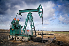 Oil pump jack. Against blue sky background Royalty Free Stock Photography