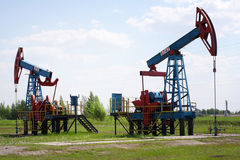 An oil pump jack Royalty Free Stock Photos