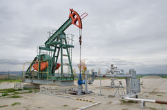 Oil pump jack. Small pump jack mining crude oil Stock Images