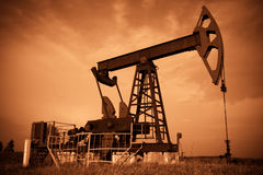 Oil pump jack. Red filtered image stock images