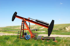 Oil pump jack. On prairie at the south of alberta, canada Royalty Free Stock Photography