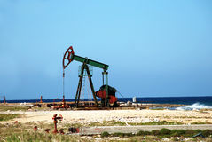 Oil pump jack at coast Stock Photo