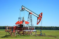 Oil Pump Jack In a field Royalty Free Stock Image