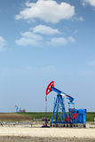 Oil pump jack on field Stock Photography
