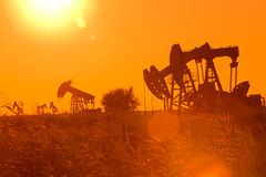 Oil Pump Jack. Oil and gas industry. Work of oil pump jack on a field Stock Photography