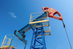 Oil pump jack. Oil industry and gas industry. Work of oil pump jack on a oil field Royalty Free Stock Photo