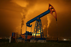 An oil pump jack Stock Images