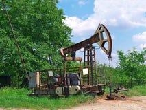 Oil pump jack Stock Photos