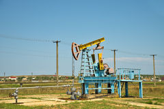 Oil pump jack in operation. Stock Photos