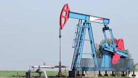Oil pump jack stock video footage