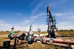 Oil pump jack. In plains Stock Photos