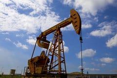 Oil pump jack Royalty Free Stock Image