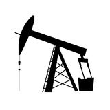 Oil pump jack silhouette Royalty Free Stock Photos