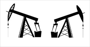 Oil pump jack silhouette Royalty Free Stock Images
