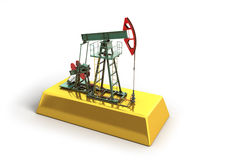 Oil pump-jack stands on a gold Royalty Free Stock Photo