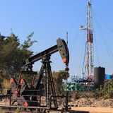 Oil Pump Jack (Sucker Rod Beam) and Drilling Rig Royalty Free Stock Image
