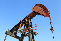 Oil Pump Jack (Sucker Rod Beam). On Sunny Day Royalty Free Stock Photos