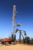 Oil Pump Jack (Sucker Rod Beam) and Workover Rig Stock Image