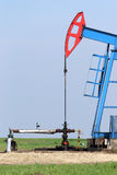 Oil pump jack. And valve with pipeline royalty free stock images