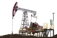 Oil pump jack. Wide view of isolated oil pump jack Stock Photography