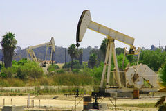 Oil Pump Jacks. Two oil pump jacks in southern California coastal area Stock Photos