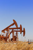 Oil pump jacks Stock Photos