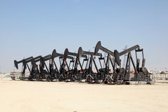 Oil pump jacks in the desert Royalty Free Stock Images