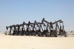 Oil pump jacks in the desert Royalty Free Stock Images
