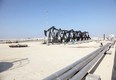 Oil pump jacks in the desert royalty free stock photography