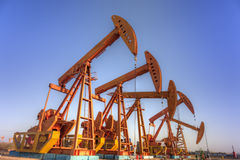 Oil pump jacks  (HDR) Stock Images