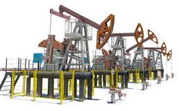 Oil pump-jacks. Isolated Royalty Free Stock Photography