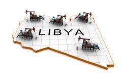 Oil pump-jacks on a map of Libya Stock Image
