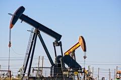 Oil `pump jacks` pumping oil Stock Photos