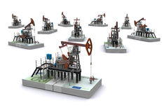 Oil pump-jacks stands on a packs of euro Stock Photography