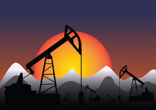 Oil pump mountain on sunset Royalty Free Stock Images