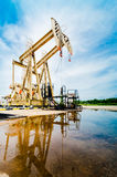 Oil pump moving. Oil industry equipment Royalty Free Stock Photography