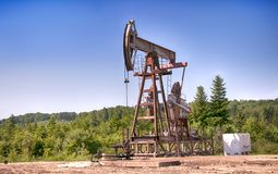 Oil pump. Is on a background mountains stock image