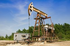 Oil pump. Is on a background mountains stock photo