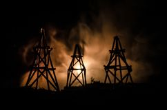 Oil pump oil rig energy industrial machine for petroleum, Group oil rigs and brightly lit industrial site at night. Toned.Backgrou. Nd for design. Selective Stock Photo