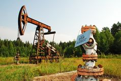 Oil pump and oil well installation Stock Photos